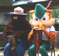 Smoky The Bear and Woodsy The Owl enjoy a Roots To Rhythm drum circle at the Marietta Earth Day Festival 2006.